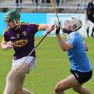 Wexford full-forward Jack Cullen grabs the ball and puts pressure on Dublin's Ben McHugh