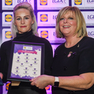 Bernie Breen receives her award from Jay Wilson of Lidl and national President Marie Hickey