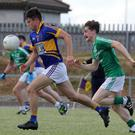 Robbie Vallejo of Geraldine O'Hanrahans is chased by Seán Doyle (Naomh Eanna)