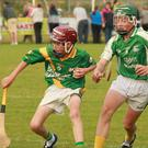 Eoin O'Meara of Buffers Alley is closed down by Brian Cushe (Naomh Eanna) during Friday's clash in Gorey