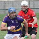 Stephen Ryan of St. Patrick's is closed down by Oulart-The Ballagh defender Ian Storey.