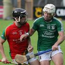 Jack Kelly (Rapparees) keeps the ball away from David O'Brien
