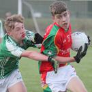 Shane Farrell of Starlights comes under pressure from Cormac Doyle (Naomh Eanna)