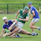 Cloughbawn's Harry Kehoe breaks away from a grounded Mark Kavanagh, and Shane Reck