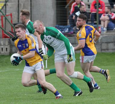 Stephen Stafford of Taghmon-Camross is chased by Brendan Doyle of St. James'