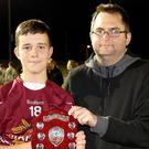 Dean Goodison of People Newspapers (sponsors) with Castletown captain Gavin McNulty