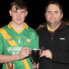 Jack Twomey, the Buffers Alley captain, with Dean Goodison of People Newspapers (sponsors)
