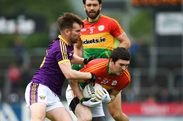 PJ Banville tackling Conor Lawlor of Carlow on what proved to be his final Leinster Senior football championship game last May.