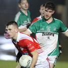 Seán O'Leary of Monageer-Boolavogue moves away from Bob Whitty
