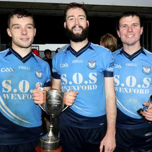 St. Anne's joint captains Seamus Mythen and Mark Furlong with full-back Tomás Cullen who won the man of the match award