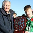 J.J. Twamley receives the shield from Pat Henderson