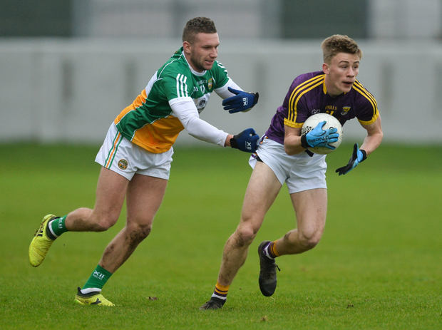 Defender Martin O'Connor - one of the 16 Senior debutants for Wexford - under pressure from Offaly captain Anton Sullivan