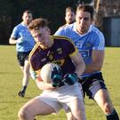 Midfielder Nick Doyle tries to shake off Dublin's Seamus Ryan