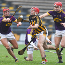 Wexford duo Paul Morris and Jack O'Connor apply the heat on Kilkenny captain Cillian Buckley during Saturday's Walsh Cup final