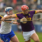Wexford's Lee Chin holds off Stephen Bennett of Waterford during Sunday's encounter in Walsh Park
