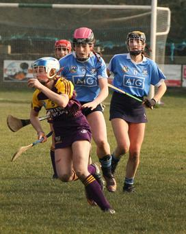 Elaine Quigley on the ball for Wexford as Niamh Gannon and Chloe Mullen track her movements