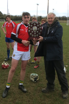 Paddy Barron receiving the shield from Pat Henderson, South Leinster Schools Servicing Officer