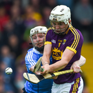 Rory O'Connor gets his shot away despite the pressure exerted by Fiontán McGibb
