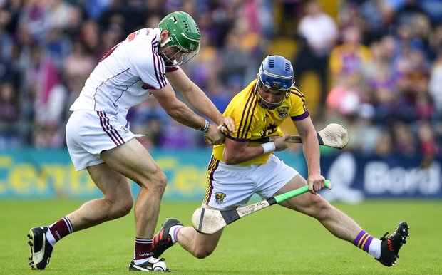 A tussle for possession in midfield between Wexford's Kevin Foley and Galway captain David Burke