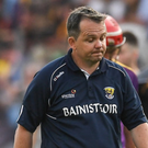 A dejected Davy Fitzgerald leaving the field along with Aidan Nolan after Saturday's one-point defeat