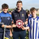 Joint captains Darby Purcell and Danny Glennon receiving the shield from Anthony Masterson