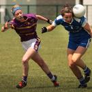 Jane Moore of Laois performs a balancing act as Kellie Kearney and Ellen O'Brien apply pressure