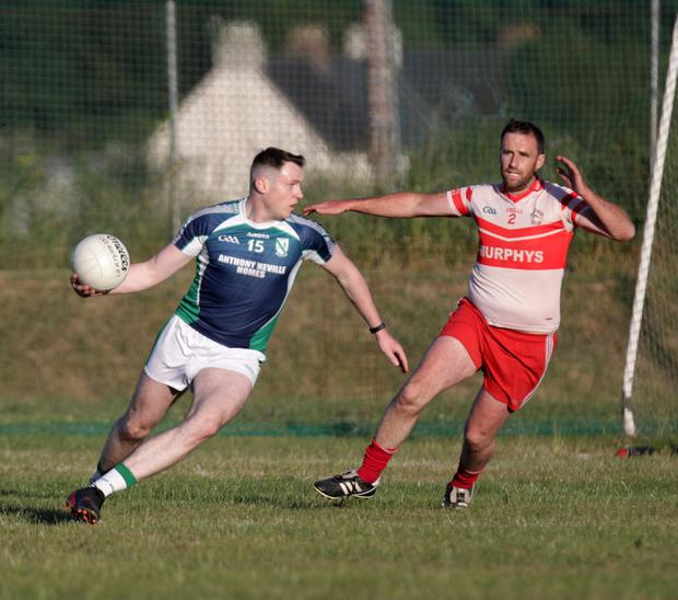 Volunteers top scorer David Shannon making life difficult for Kilanerin defender Lorcan Clare