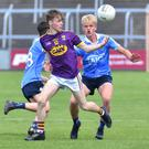 Wexford's Lee Nolan tries to keep the ball away from Euan Farquharson on Dublin