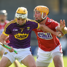 Wexford defender Ian Carty holding off Declan Dalton of Cork during Saturday's heavy defeat in Nowlan Park. Photo by Matt Browne/Sportsfile