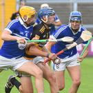 Rathnure's Aidan Redmond has no room to manoeuvre as Damien and Shane Reck shut him down