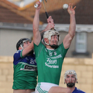 Cathal Dunbar (Naomh Eanna) leaps into the air in search of possession with Jack Fenlon (Glynn-Barntown) breathing down his neck