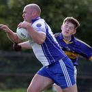 Gary Keating of Craanford is tackled by Kevin Power (Rosslare)