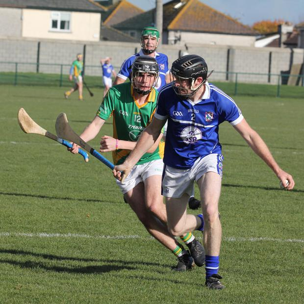 Aidan Murphy of Oylegate-Glenbrien on the ball as Paddy Barron (Rathgarogue-Cushinstown) closes him down