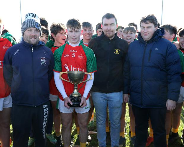 J.J. Twamley of Naomh Eanna with the Syl Barron Memorial Cup along with Brian Carty (representing People Newspapers), Liam Barron and David Tobin (Coiste na nOg Secretary)