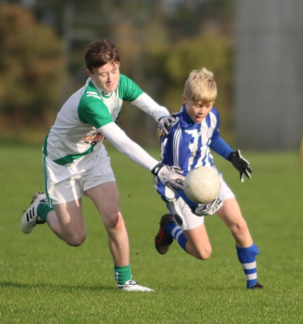 Cillian Byrne of Good Counsel trying to give Daniel Ormonde the slip