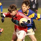 Rory Dineen of Gorey is tackled by Taghmon's Morgan Nash-Colfer