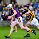 Local lad Liam Ryan bursting out of defence despite the best efforts of Kilkenny's Kevin Kelly in Bellefield on Sunday