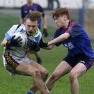 Aaron Ó Coigligh (Meanscoil Gharman) is tackled by Shane Cleary