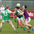 Wexford attacker John Tubritt grappling for the ball with London's Barry Tully. Photograph: P.J. Howlin.