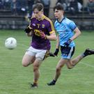 Wexford wing-back Paddy Darcy stealing a march on Dublin's Alex Watson