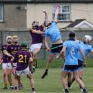 Wexford's Cian Molloy makes a spectacular catch to deny Ben McSweeney of Dublin