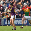 Liam Og McGovern gets the better of Carlow corner-back Kevin McDonald in the comprehensive 2-28 to 0-19 victory in Innovate Wexford Park on Saturday