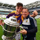Manager Davy Fitzgerald with Conor McDonald and the Bob O'Keeffe Cup