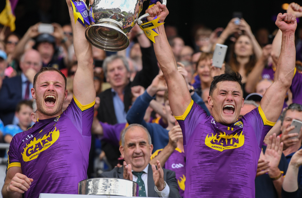 A fantastic moment 15years in the making as joint captains Matthew O'Hanlon and Lee Chin lift the Bob O'Keeffe Cup