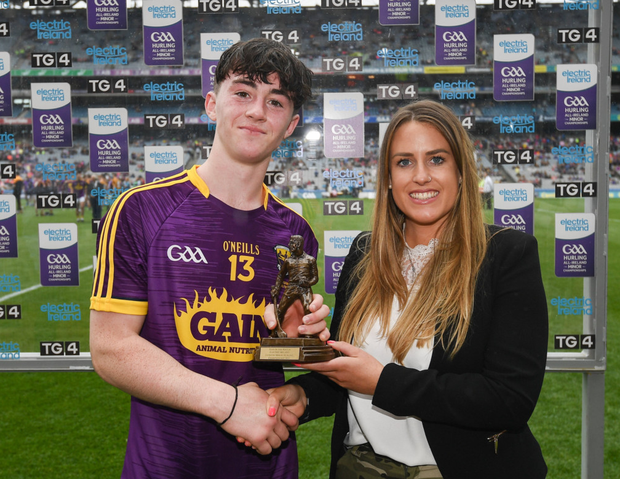 A.J. Redmond, seen here receiving the player of the match award after the Minor final, was later crowned National Minor Hurler of the week
