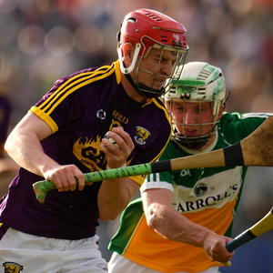Full-forward Conall Clancy breaking through the challenge from Offaly defender Ryan Hogan on theway to scoring his first-half goal