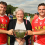 Caroline Foxe presenting the Foxe Cup to Fethard's joint captains, Garrett Foley and Graham O'Grady