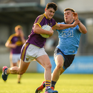 Wexford attacker Michael Molloy taking on Dublin defender Neil Matthews