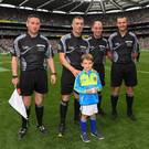 James Owens before the 2018 All-Ireland final with six-year-old Rian O'Connor, who presented him with the match ball, and his fellow officials Fergal Horgan (Tipperary), Seán Cleere (Kilkenny) and Patrick Murphy (Carlow) - referee for the Minor final between Galway and Kilkenny next Sunday