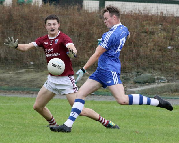 Jamie Doyle of Craanford taking aim as Conor Kelly (St. Martin's) tries to block his kick